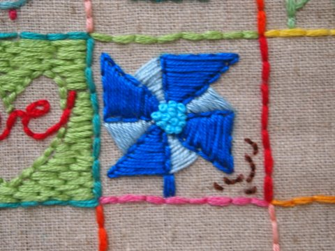 Embroidered square pin wheel