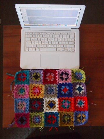 Crocheting granny squares laptop