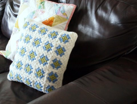 Granny square cushion on sofa