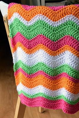 Pink orange green ripple blanket